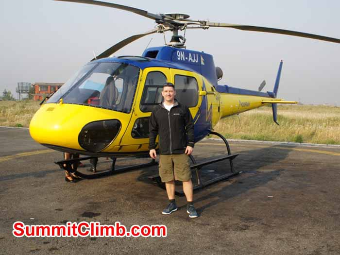 Gary Murray with the helicopter which brought him to Lukla.