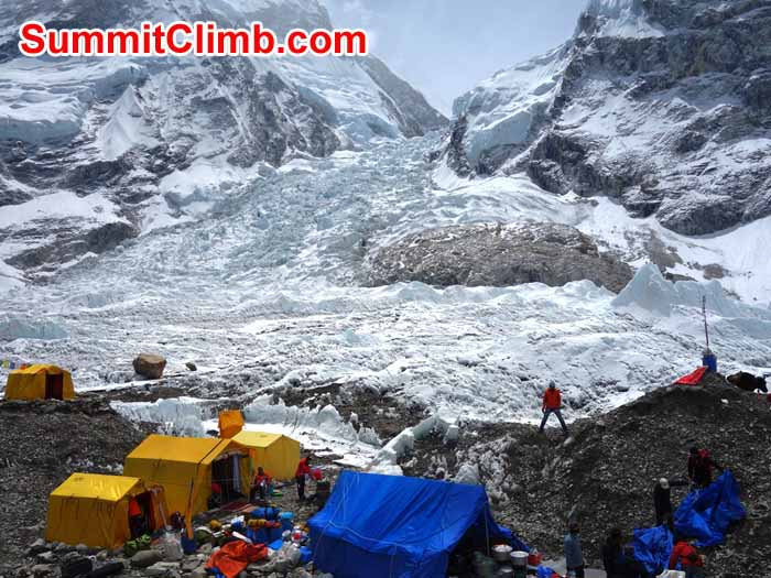 Packing up basecamp. Icefall behind. Photo David Maidment
