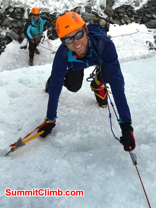 David Maidment climbs ice while Jangbu Sherpa instructs. Dan Mazur photo