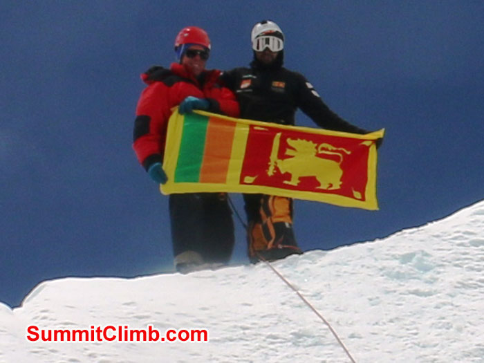 Elmo and Dan hold the flag of Sri Lanka on the top of Mount Jangbu in the Khumbu Glacier near Everest Basecamp. Photo by Gary Murray
