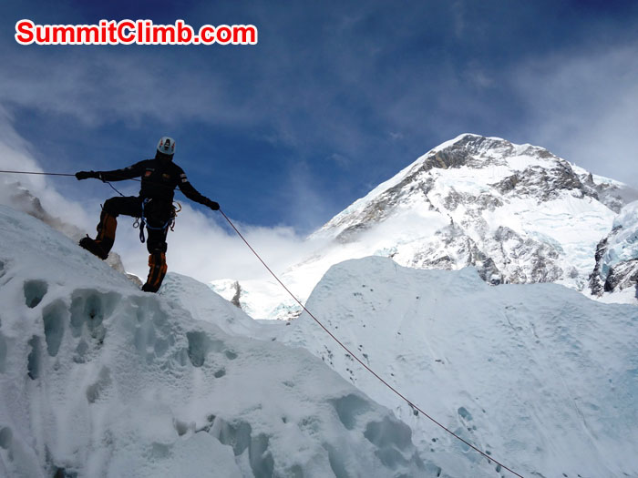 Elmo Francis practices a body rappel below the West Ridge of Everest. Photo by David Maidment