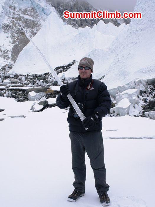 Gary Murray holds a giant icecicle he found in the Khumbu Glacier near Everest Base Camp. Photo by Elmo Francis