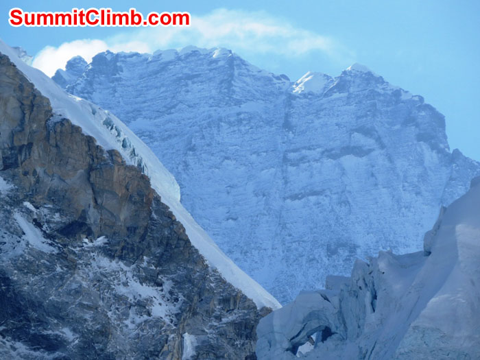 Snow encrusted western wall of Lhotse looms above the west idge of Everest and the Khumbu Icefall in this zoom shot by Elmo Francis