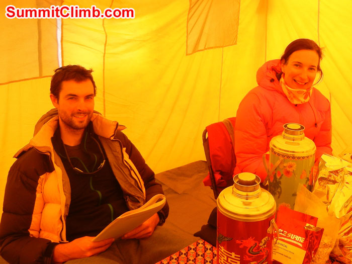 Mia sending an email and Tom reading in our cozy Basecamp  Dining Tent - Photo Scott Patch