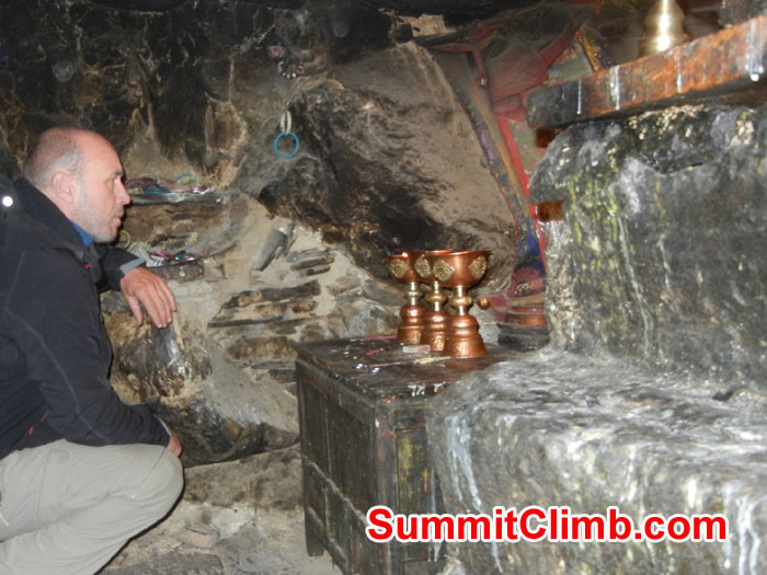 Garry inside cave at Ancient Rongbuk Monestery asking Mt Chomolungma for safe passage - Photo Scott Patch