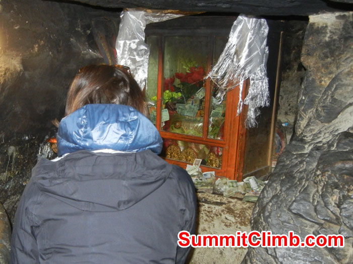 Mia inside cave at Ancient Rongbuk Monestery asking Mt Chomolungma for safe passage - Photo Scott Patch