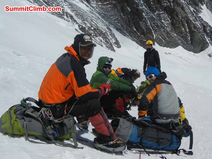 Team members taking a break while climbing to the North Col - Photo Scott Patch
