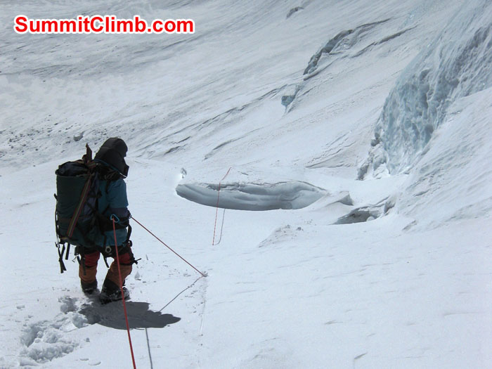 Sherpa pulling fixed line above fresh snow on North Col - Photo Mia Graeffe