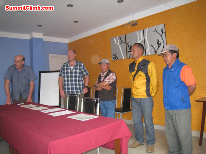 Team briefing at the Shakti hotel - Dan, Arnold, Jangbu, Lakpa, and Kaji. Scott Smith Photo.