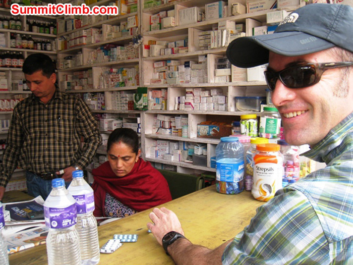 Patrick Dougherty purchasing medicines and water in Kathmandu.Scott Smith Photo