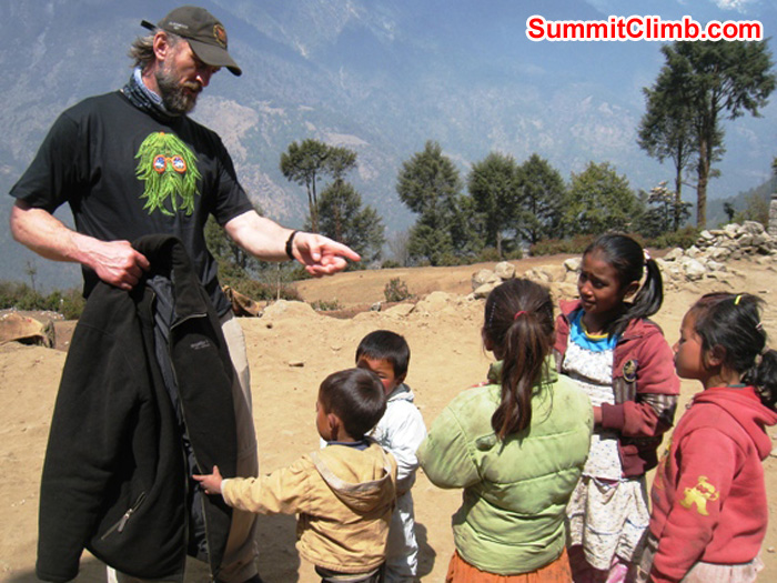 Adam Dixon conducts an impromptu class for local kids at Lukla. Scott Smith Photo.