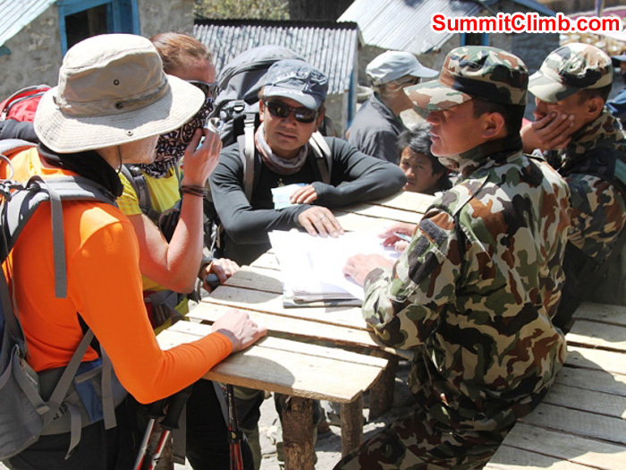 Nepal Army soldiers check permits at Fungki Thangka at the base of the Tengboche Hill. Monika Witkowska Photo.