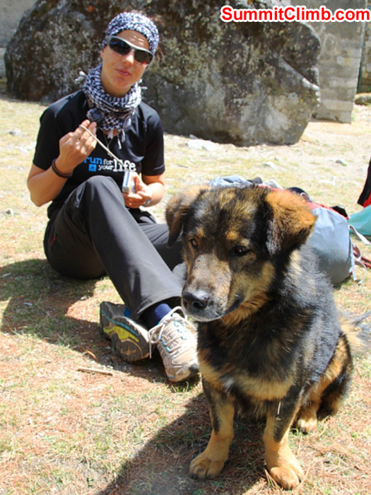 Sandra and a local village dog take a break. Monika Witkowska Photo.