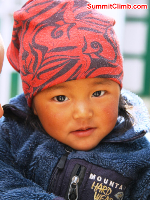 Sherpa child wearing a Mountain Hardwear jacket in Namche. Monika Witkowska Photo.