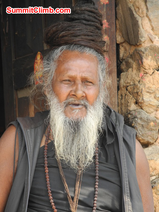 Holy man at the Pashputinath Temple in Kathmandu. His long hair is coiled upon the top of his head. Violetta Pontinen Photo.