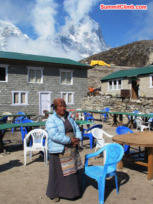 Pasang Sherpani is the boss of the Thughla Lodge. Cholatse in the background. Monika Witkowska Photo.