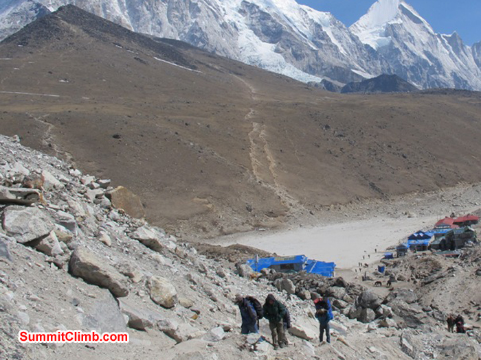 Trekkers reaching Gorak Shep. Lodges and the famous Kala Pattar view ridge in the background. Monika Witkowska Photo.