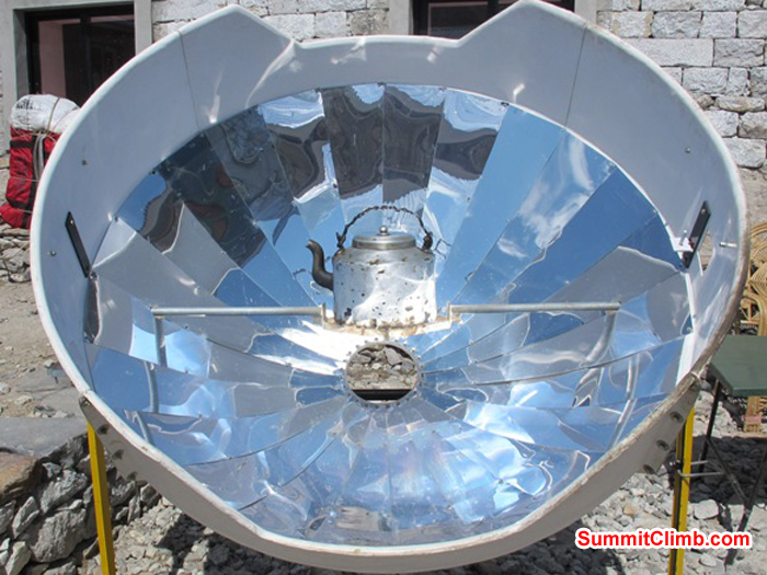 Solar oven heats a kettle of water at the Himalayan Lodge in Gorak Shep. Monika Witkowska Photo.