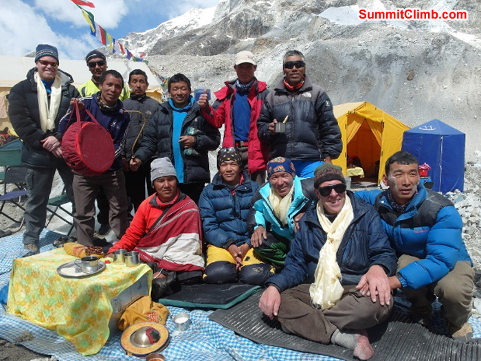 Scott Smith and Sherpa climbing team pose with Pangboche Lama and Dan Mazur during basecamp blessing ceremony. Monika Witkowska Photo.