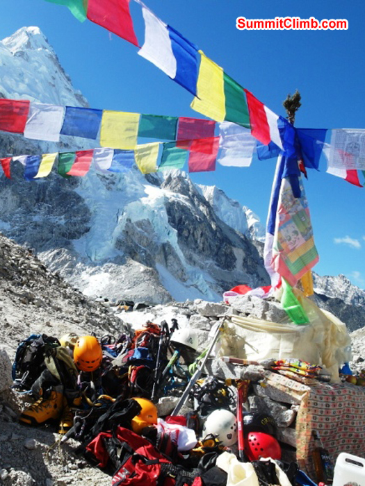 Everest and Lhotse team member's climbing gear spread around the alter during the basecamp blessing ceremony. Monika Witkowska Photo.