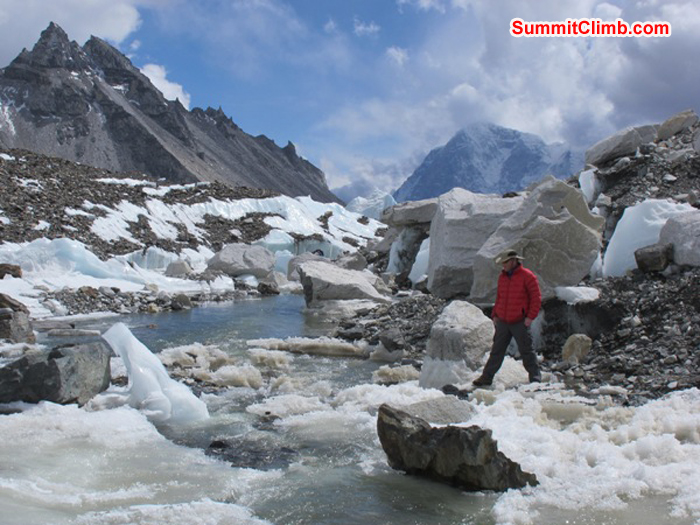 Scott Smith crossing a river in the Khumbu Glacier, while exploring arounf basecamp. Monika Witkowska Photo.