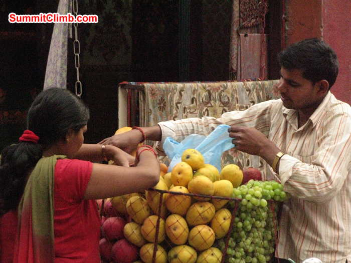 Locals buying fruit locally in street. Photo Rares Voda