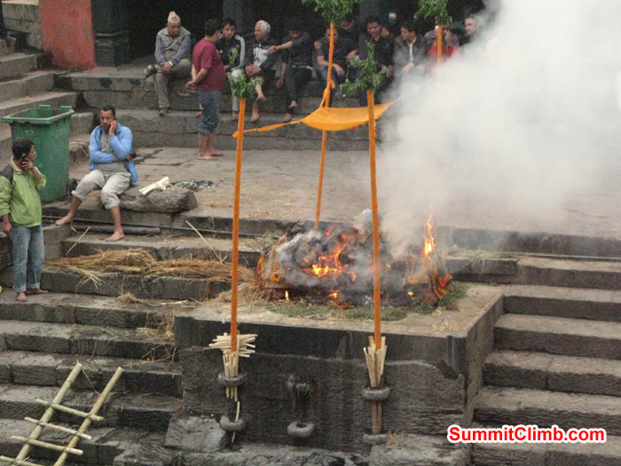 9.	Hindu Cremation at Pashupati Temple on the Bagmati River in Katmandu Nepal . Burning Funeral Pyres on the riverbanks of the Bagmati River that flows through the Kathmandu Valley. Photo Rares Voda