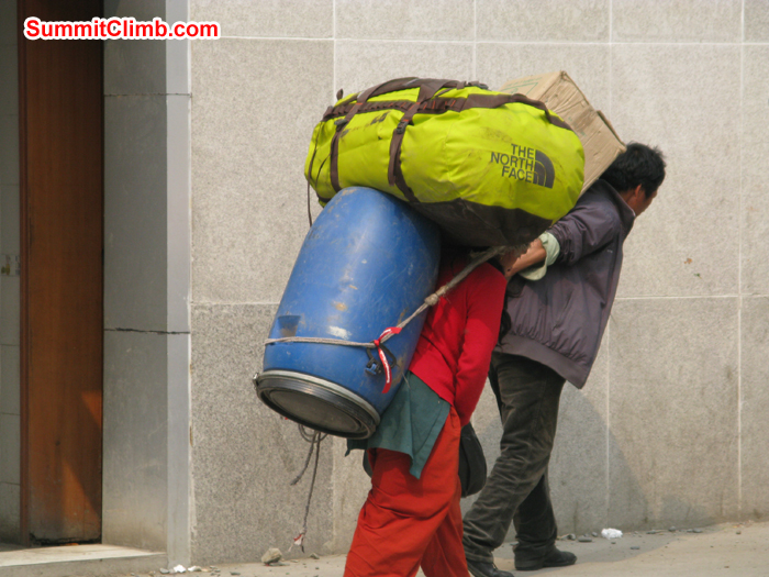 Porters carrying duffle bags and drums. This is the way we transport our expedition loads from Nepal side to China side. Photo Rares Voda