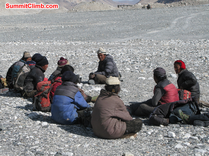 Yak drivers waiting for expedition load at Chinese base camp. Photo Rares Voda
