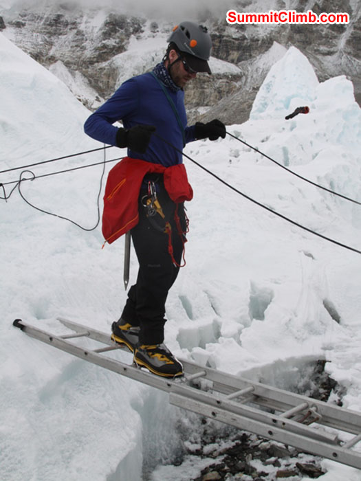 Chris Longacre practices a ladder crossing in the Khumbu Glacier near basecamp. Monika Witkowska Photo.