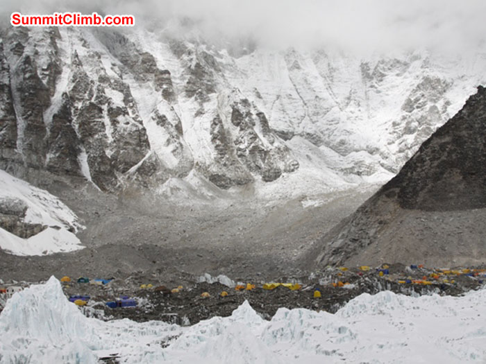 Everest basecamp nestles amongst the tall peaks and the Khumbu Glacier. See the line of glacial recession on the slopes on the right. Monika Witkowska Photo.