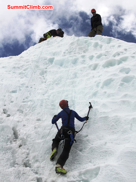Sandra Grosskinsky climbs ice while Sange Sherpa and Anne-Mari look on. Monika Witkowska Photo.