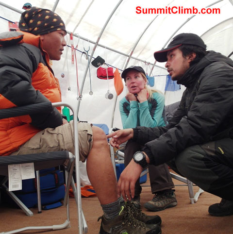 Sange Sherpa, suffering a knee injury from the Khumbu Icefall, being examined by HRA Everest ER basecamp hospital doctors. Monika Witkowska Photo.