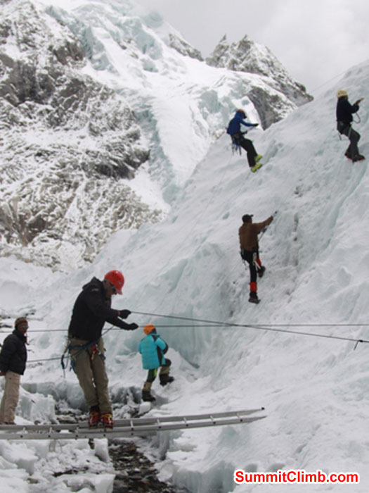 Team practices ladder crossings and ice climbing ascending and descending in the Khumbu Glacier near basecamp. Monika Witkowska Photo.