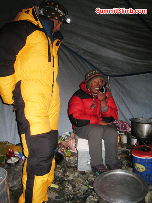 Sange Sherpa Watches Kipa Sherpa Make a Radio Update in Camp 2.