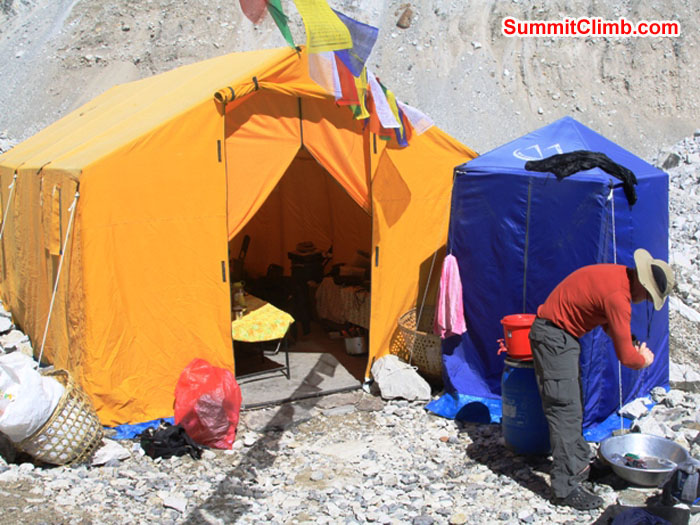 Basecamp Life. Scott Smith doing his laundry in front of the dining tent. Monika Witkowska Photo
