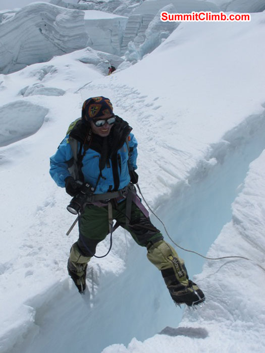 Jangbu Sherpa jumps a crevasse in the Khumbu Icefall. Monika Witkowska Photo
