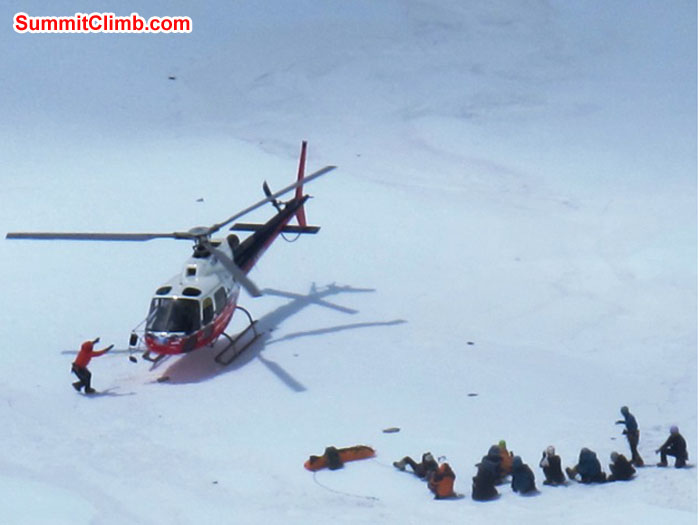 Rescue helicopter in camp 2. Victim lies on stretcher. Photo taken with respect by Monika Witkowska