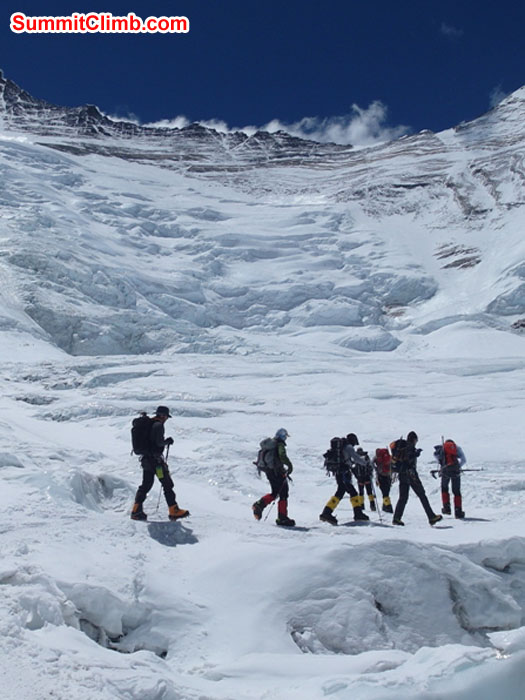 Team walking in the Western Cwm at the base of the Lhotse face. Monika Witkowska photo