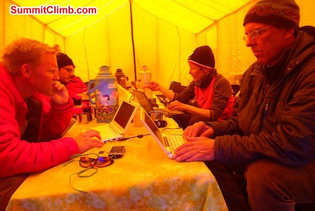 Team works on computers and different tech stuff in the dining tent. Photo by Anne-Mari Hyrylainen