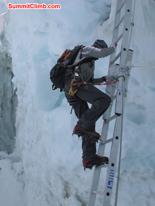 Thile Nuru Sherpa ascends a vertical ladder in the Khumbu Icefall. Monika Witkowska Photo