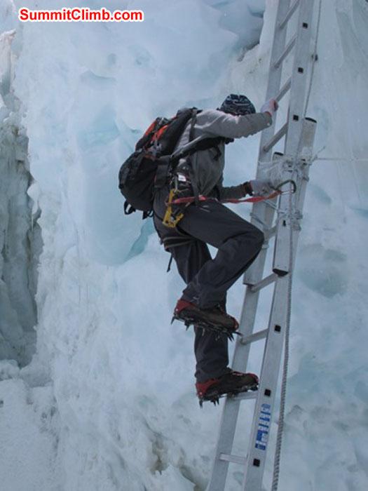 Thile Nuru Sherpa ascends a vertical ladder in the Khumbu Icefall. Monika Witkowska Photo