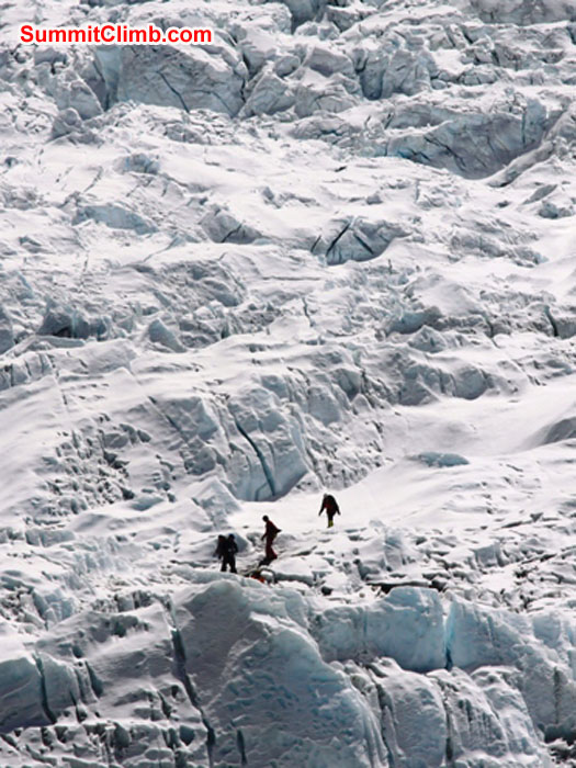 Tiny team walking in the giant icefall. Monika Witkowska Photo