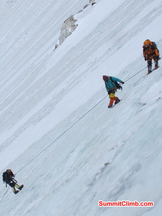 Team climbing the steep Lhotse face to camp 3 at 7000 metres - 23,000 feet. Monika Witkowska Photo.
