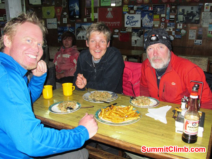 Scott Smith, Monika Witkowska, and Kieran Lally enjoying a delicious dinner in Lobuche. Photo by Slavo.