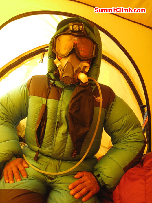 Jangbu prepares for the summit in the tent in South Col. Scott Smith Photo.