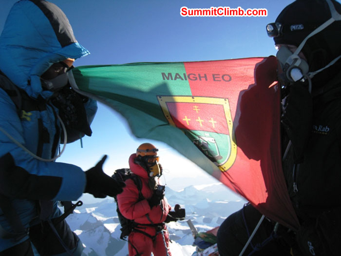 Jangbu Sherpa and Kieran Lally holding the County Mayo flag on the Summit of Everest while a Sherpa stands in the background. Photo by Scott Smith.JPG