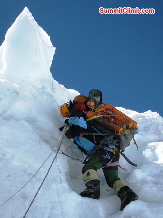 Jangbu Sherpa carrying 17 empty oxygen bottles down to basecamp. Scott Smith Photo.JPG