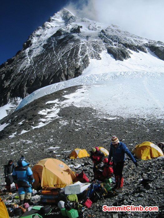 Mingma Sherpa, Jangbu Sherpa, Monika Witkowska, and Kieran Lally in the high camp at the South Col. Mt. Everest Summit in the background. Scott Smith Photo.