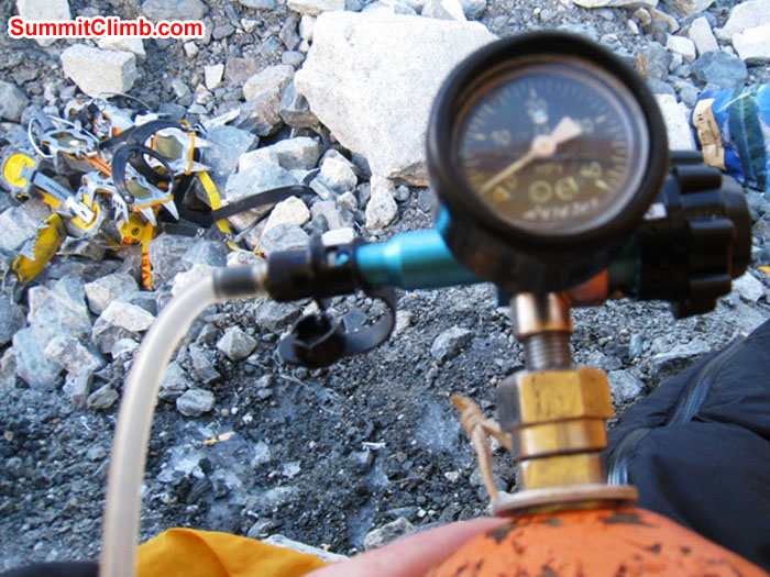 Oxygen bottle, regulator, and gear in camp 2. Scott Smith Photo.